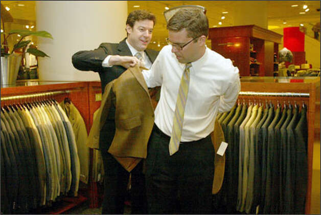 Brett Blake, left, shows Clay Nielsen a sport coat at the downtown Seattle Nordstrom. Nielsen has bought from Blake for about nine years. Photo: Phil H. Webber/Seattle Post-Intelligencer
