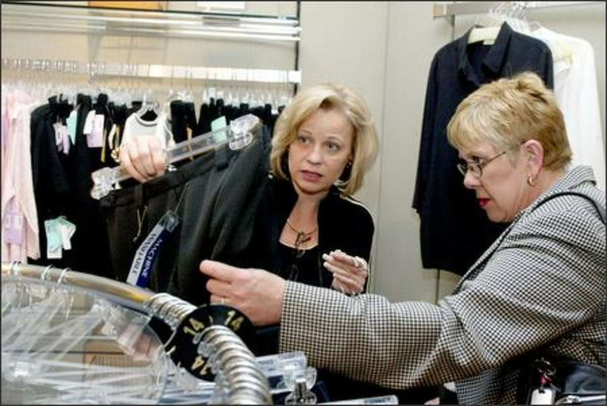 Lynn Mahlum helps Linda Capato with buying a new outfit at Southcenter Nordstrom. Mahlum sold more than $1 million in merchandise at the store last year.