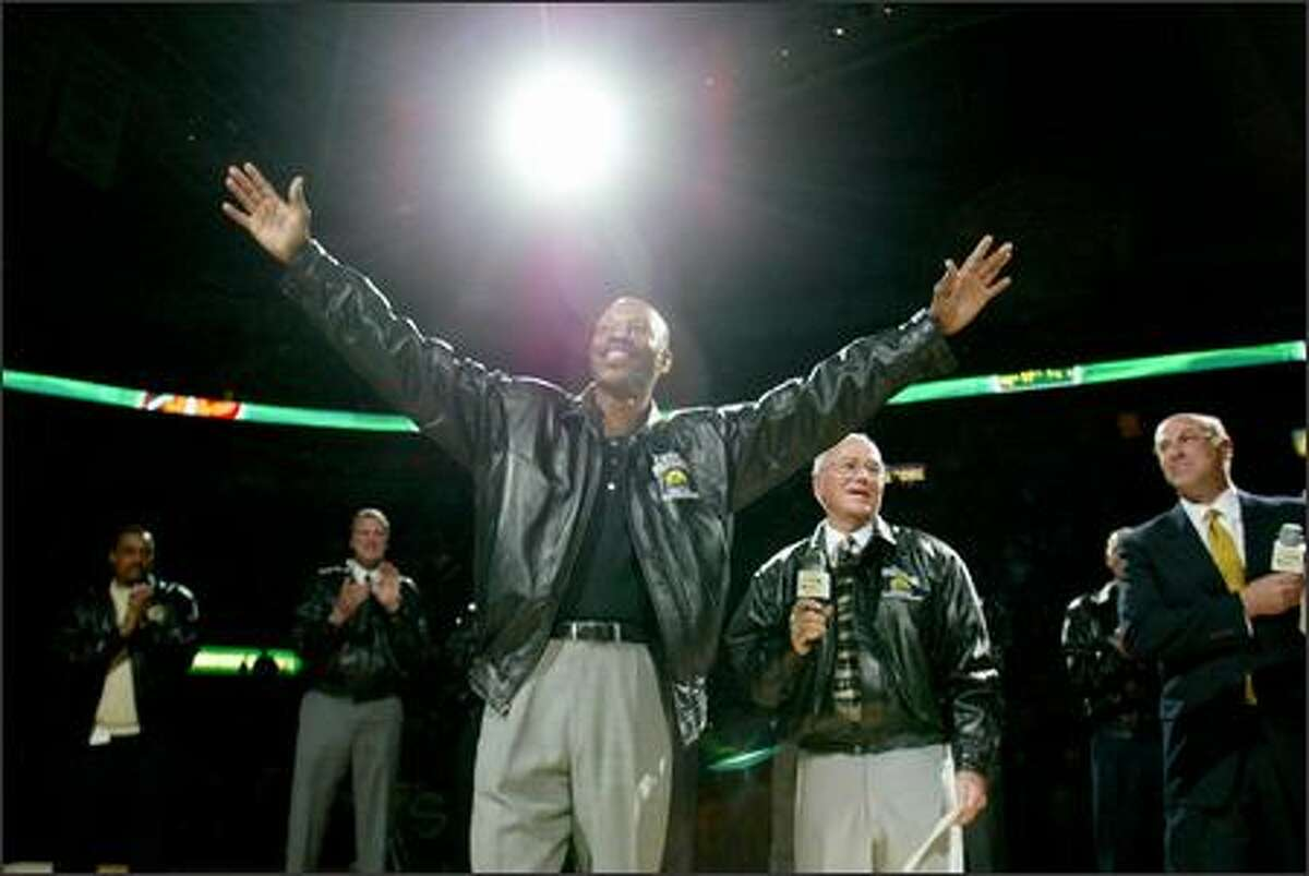 Retired Sonics great Gus Williams acknowledges the fans' cheers at KeyArena last night when his jersey No. 1 was raised to the rafters.