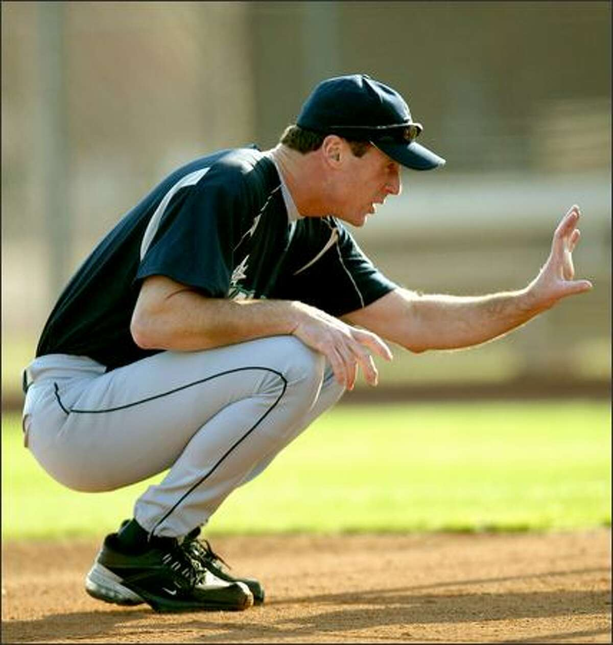 Manager Bob Melvin faces pressure to lead the Mariners to the playoffs.