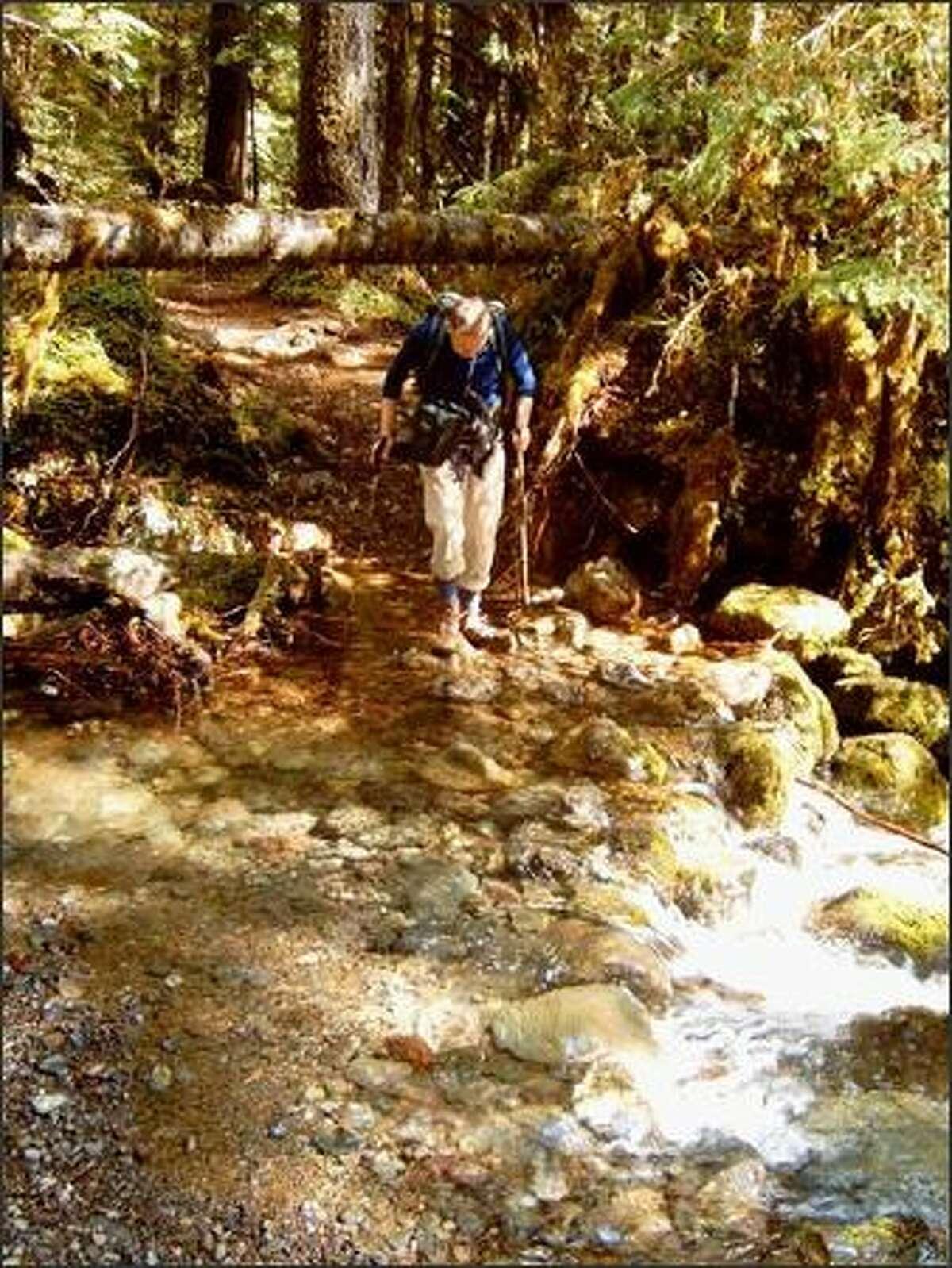 Hiker John Walenta crossing Jolly Creek.