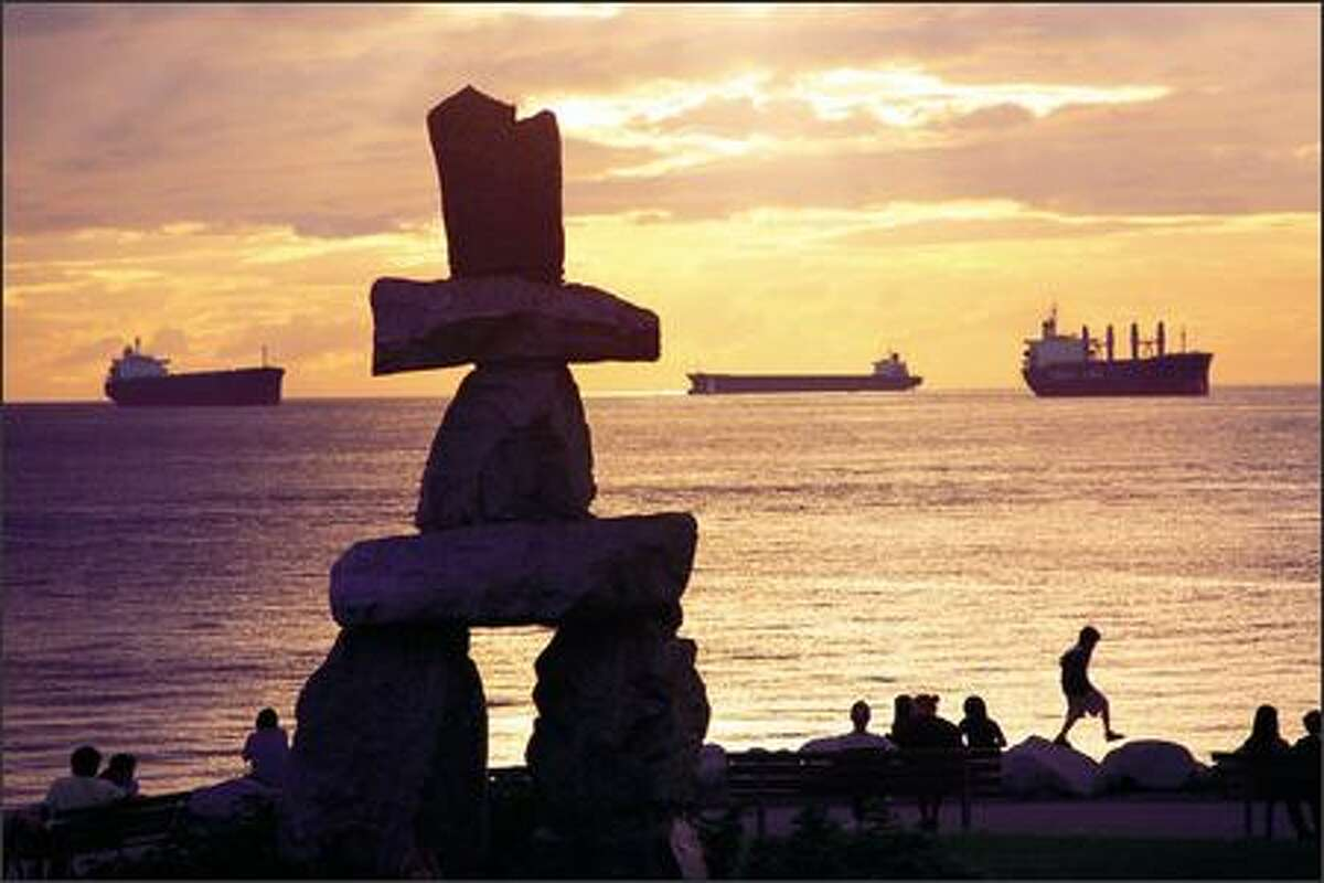 At English Bay, seawall visitors clamber about the giant Inukshuk, an Inuit sculpture, at the aptly named Sunset Beach. From here it's an easy, scenic stroll or bike ride to Stanley Park.