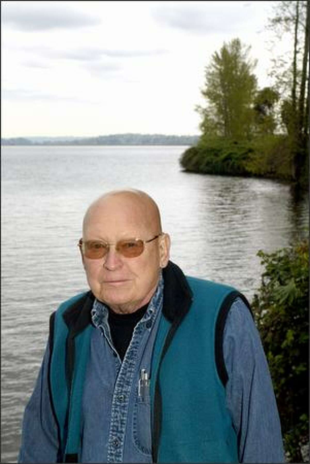John Davidson, nearly 80 years old, walks at least a mile a day, frequently two, on the slopes of Lake Washington.