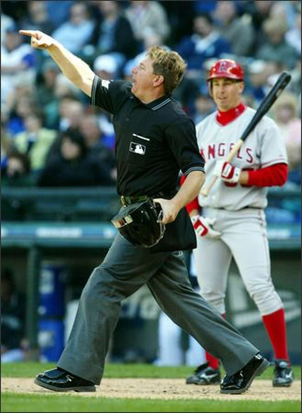 Mariners reliever Shigetoshi Hasegawa disagreed with umpire Greg Gibson's balk call, which gave the Angels a 3-1 lead in the ninth inning.