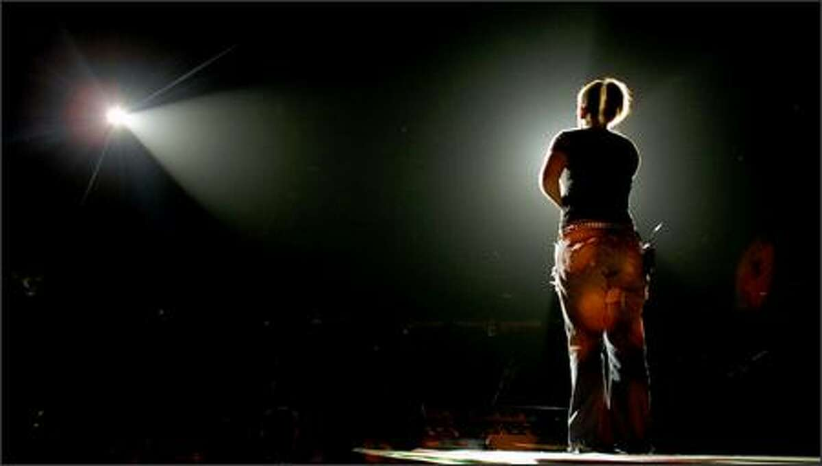 Kelly Clarkson performs at KeyArena. View a photo gallery of Clarkson and Clay Aiken's show Thursday night.
