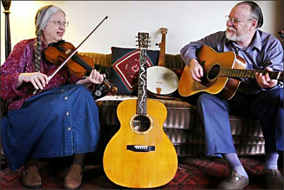 Vivian and Phil Williams have made it their lives' work to keep old-time American music alive. She is a fiddler and he plays guitar, mandolin, banjo and bass. Photo: Joshua Trujillo/Seattle Post-Intelligencer