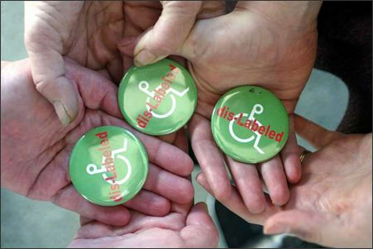 """Many people worked on a bill in the Legislature's recent session promoting """"respectful language."""" Their lobbying effort included buttons."""