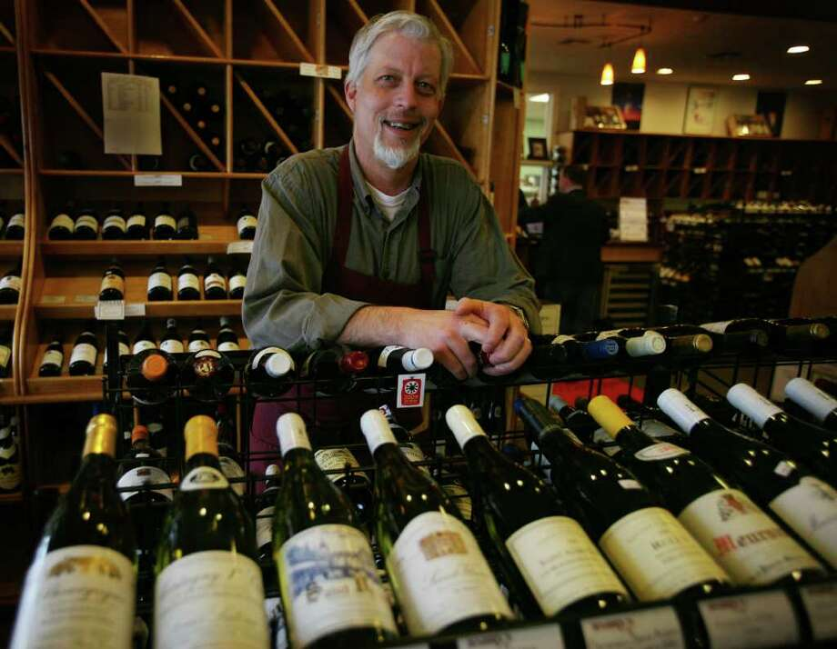 Patrick Monteleone, general manager of Harry's Wine & Liquor Shop in Fairfield, is against Sunday liquor sales in Connecticut, an idea that has been championed by new Governor Dannel P. Malloy. Photo: Brian A. Pounds / Connecticut Post