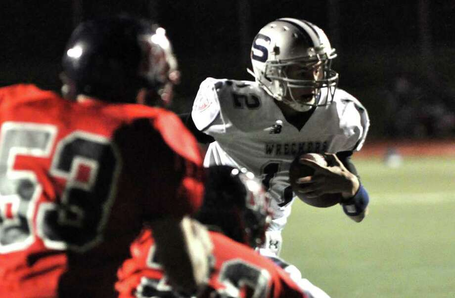 Quarterback Chet Pajolek runs towards the end zone for a touchdown during the Wreckers' 21-13 win Friday at McMahon. Photo: Amy Mortensen, ST / Connecticut Post Freelance