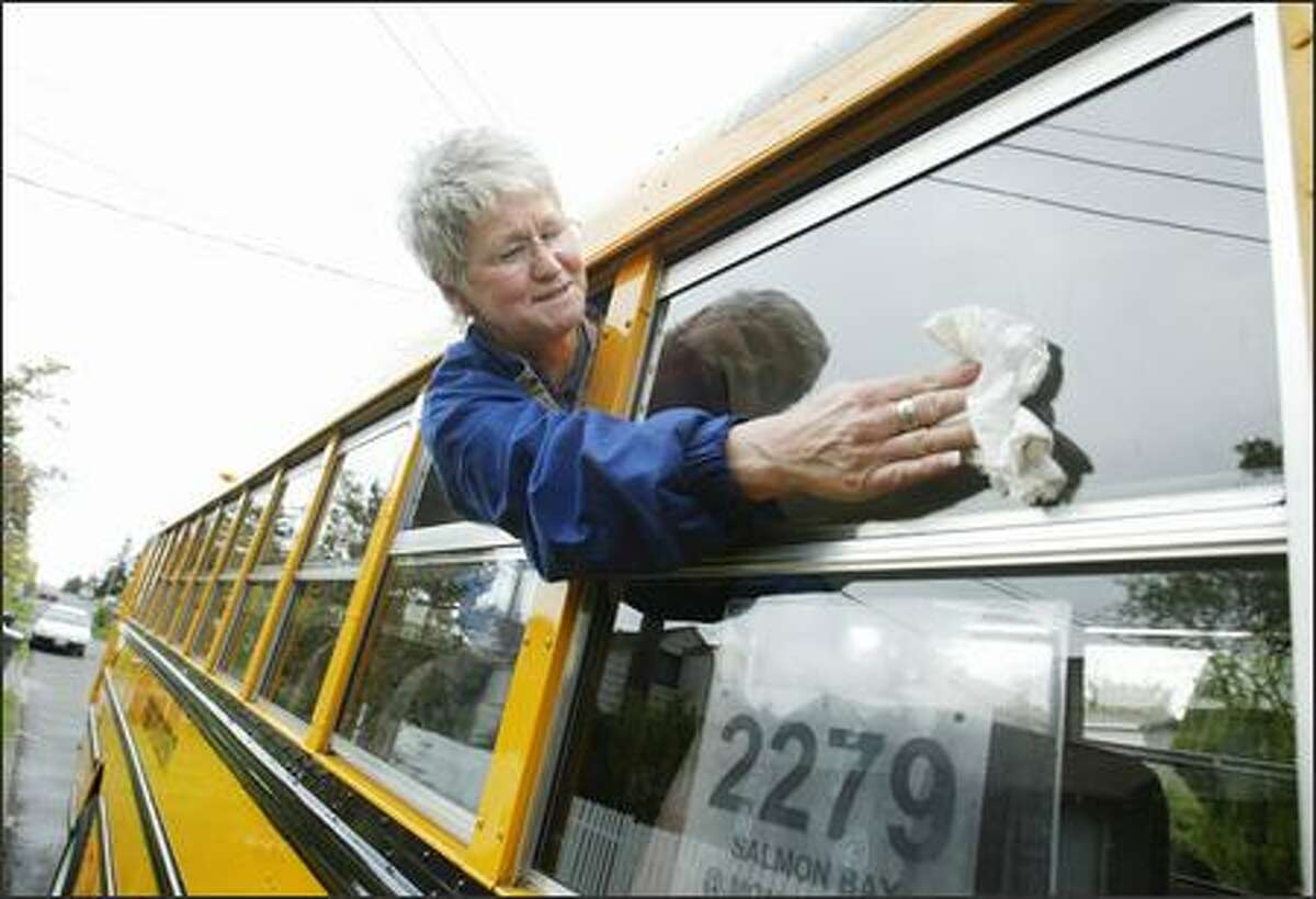 Gina Wallin keeps her school bus as cheerful as her attitude. No matter the route, which is seen in the window, she believes spiffy buses rub off on kids.