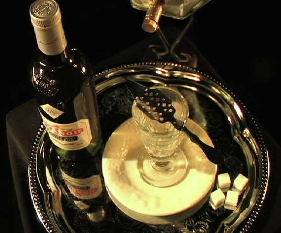 Part of the mystique of absinthe is the ritual involved in drinking it. Above, is an absinthe set up. Photo: Contributed Photo / Greenwich Citizen