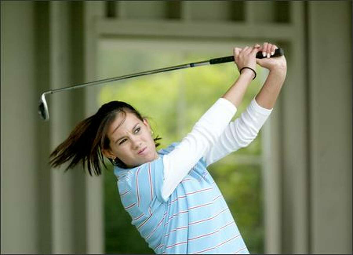 Redmond junior Whitney Ammerman switched to golf after tearing a ligament in her knee while playing basketball.