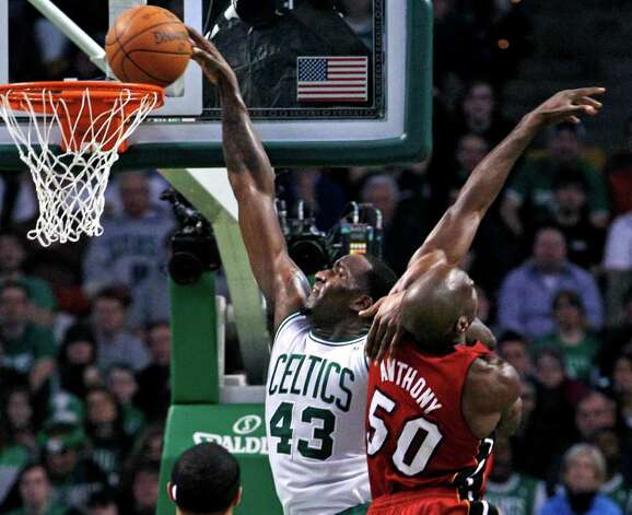Boston Celtics center Kendrick Perkins (43) scores over Miami Heat center Joel Anthony (50) during the first half of an NBA basketball game in Boston, Sunday, Feb. 13, 2011. (AP Photo/Elise Amendola) Photo: Elise Amendola, STF / AP