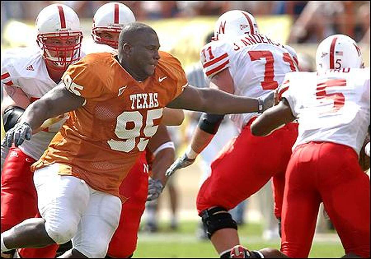 Texas' Marcus Tubbs strips the ball away from quarterback Jammal Lord (5) during the second quarter in Austin, Texas, in this Nov. 1, 2003, photo. Tubbs was selected by the Seattle Seahawks as the 23rd overall pick in the first round of the NFL Draft on Saturday.