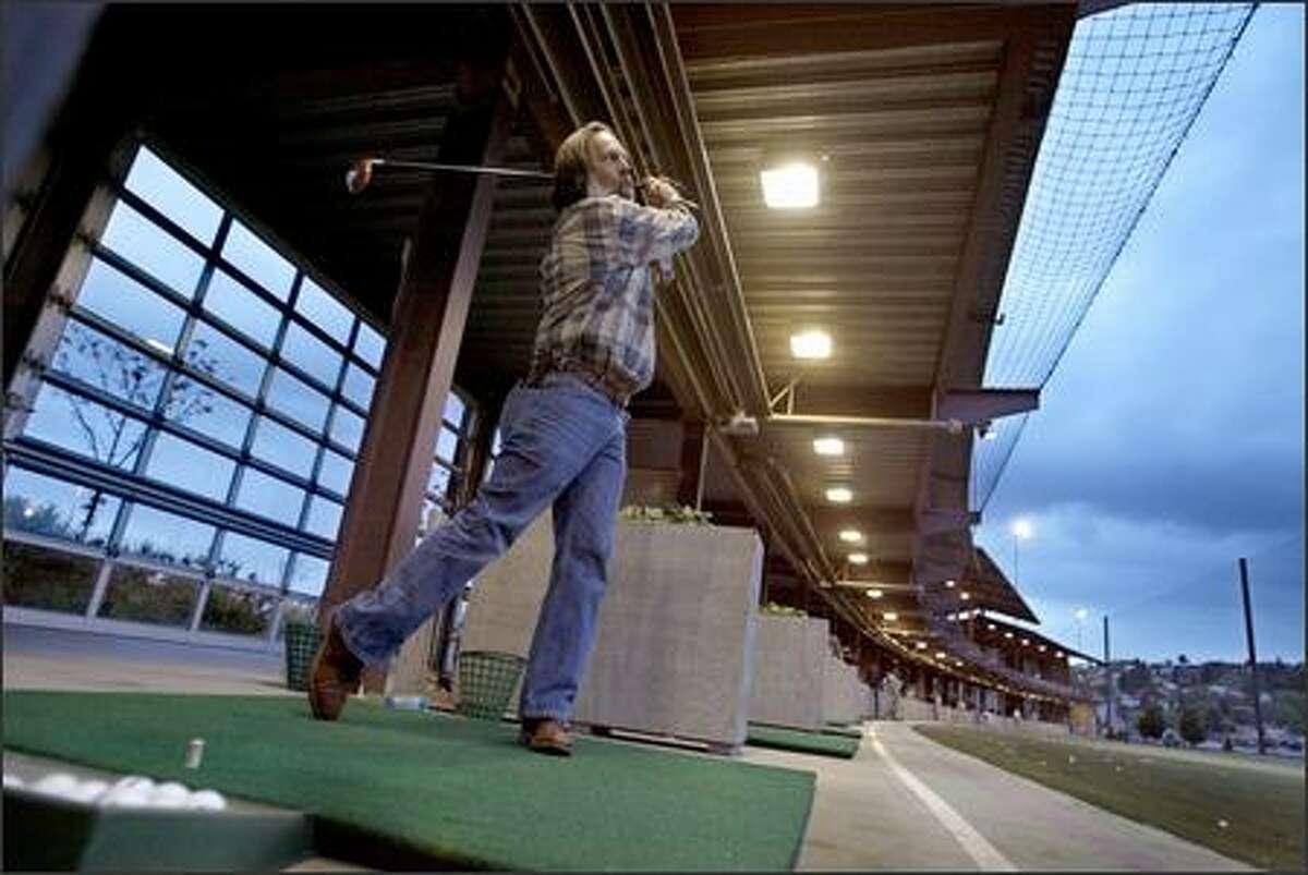 Ken Townsend of Sequim refines his swing at Interbay's popular double-decker driving range.