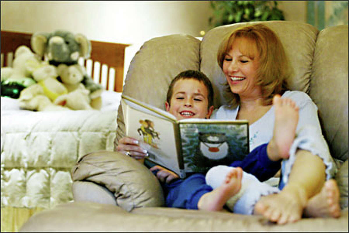 As part of their bedtime routine, Elizabeth Pantley reads to her 4-year-old son, Coleton. Pantley has written a best seller on gentle ways to get your baby to sleep.