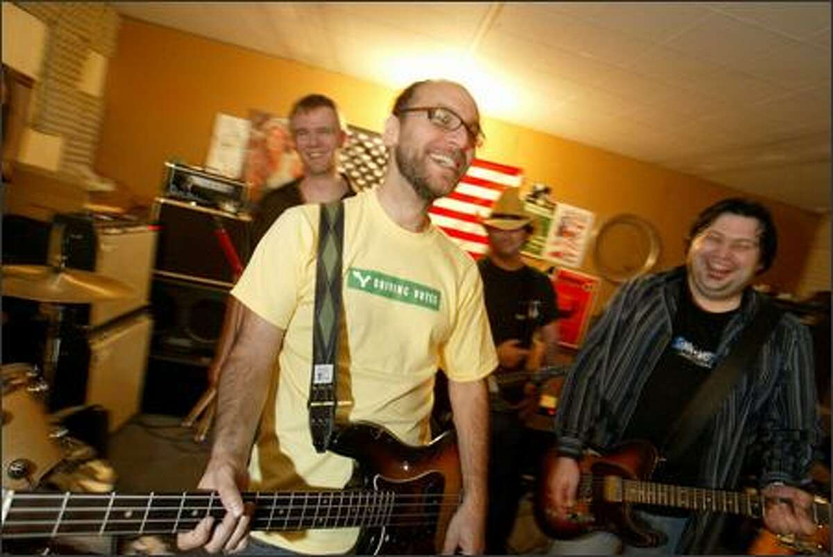 Bassist Rich Davidson, center, with the other members of the band Radio Nationals, plans to take an RV caravan to swing states to register new voters.