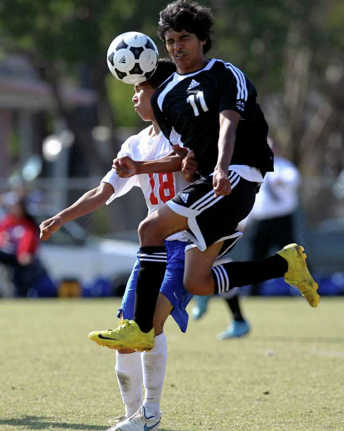 Edison's Jorge Rincon (11) and Jefferson's Guerrero Osvaldo (18) collide on a header in boys soccer at San Antonio ISD Spring Sports Complex on Tuesday, Mar. 15, 2011. Jefferson defeated Edison, 3-1.