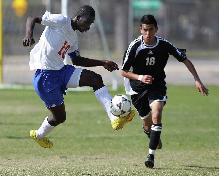 Jefferson and Edison high school players tangle at SAISD's Spring Sports Complex in March. Two letter writers differ on welcoming pro soccer to San Antonio. Photo: San Antonio Express-News, Kin Man Hui / San Antonio Express-News