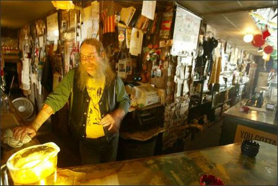 It's Pat Davies' turn to run the show at the Eastlake Zoo Tavern. Davies, 49, has been working there since 1984, but he's been a customer for longer than that. Photo: Scott Eklund/Seattle Post-Intelligencer