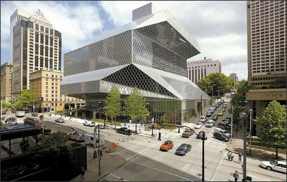Rem Koolhaas' Seattle Central Library hangs its hat with other Seattle audacities, from the Space Needle and the Flash Gordon monorail to Frank Gehry's Experience Music Project and the Fremont Troll. Photo: / Seattle Post-Intelligencer