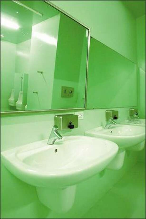 The men's restrooms at the new library were purposely painted a hideous green to discourage long-term use by patrons or the homeless. Photo: / Seattle Post-Intelligencer