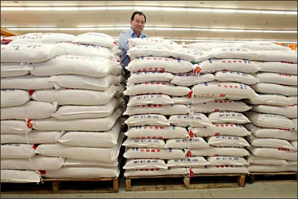 Duc Tran sells nearly 6 tons of rice a week at his Viet-Wah, said to have the Northwest's widest selection of Southeast Asian foods.