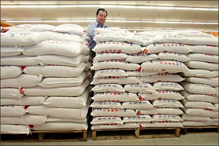 Duc Tran sells nearly 6 tons of rice a week at his Viet-Wah, said to have the Northwest's widest selection of Southeast Asian foods. Photo: Mike Urban/Seattle Post-Intelligencer