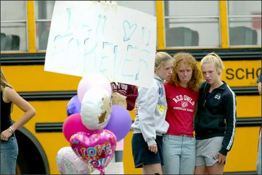 Students mourn classmate Dayna Fure at a makeshift memorial at Stanwood High School in Stanwood yesterday. Fure's father found her and her ex-boyfriend dead in her bedroom Monday afternoon. The man, Mario Valentin, had stalked Fure for months after their break-up, police said. Photo: Karen Ducey/Seattle Post-Intelligencer