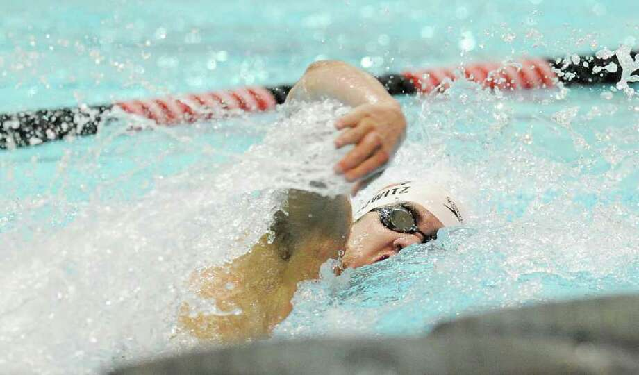 Eric Minowitz of Greenwich High School competes in the 100 yard freestyle event during the CIAC Boys Class LL State Open swimming championships at Wesleyan University, Middletown, Conn., Tuesday night, March 15, 2011. Photo: Bob Luckey / Greenwich Time
