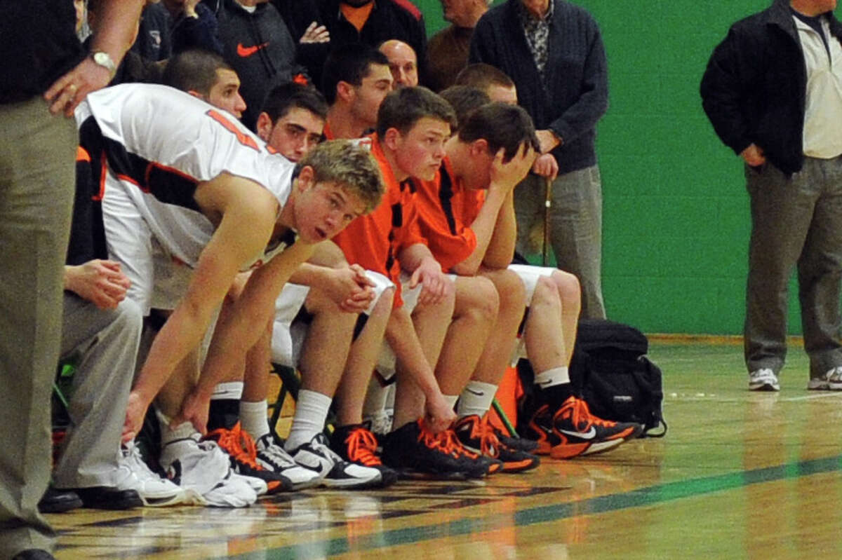 Players on Ridgefield's bench react as their team falls behind during Tuesday's class LL semifinal game at Wilby High School in Waterbury on March 15, 2011.