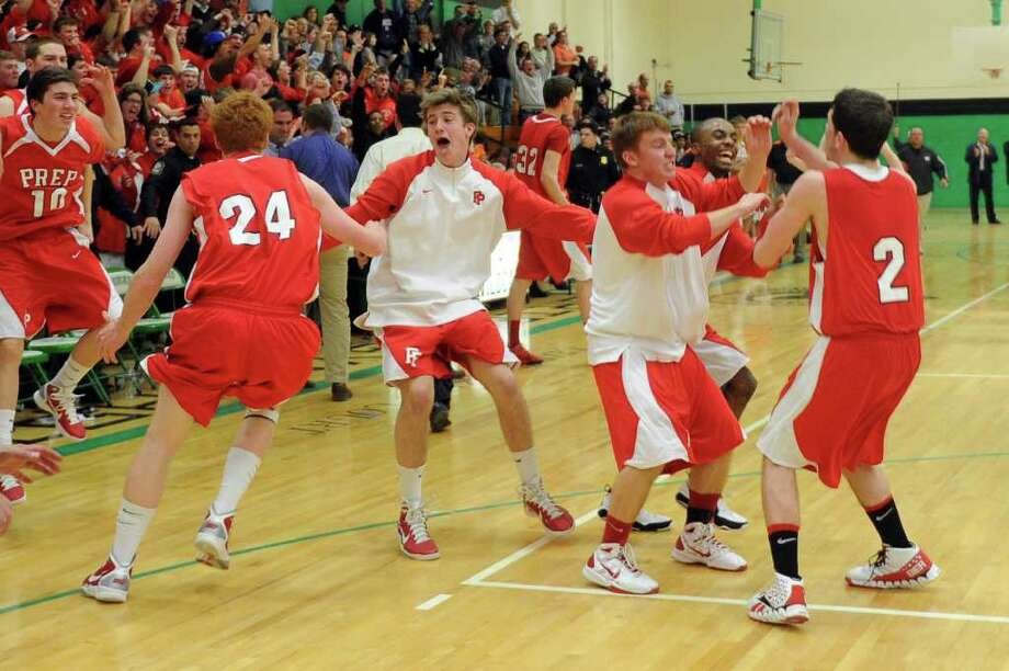 Fairfield Prep players react to winning Tuesday's class LL semifinal game at Wilby High School in Waterbury on March 15, 2011. Photo: Lindsay Niegelberg / Connecticut Post