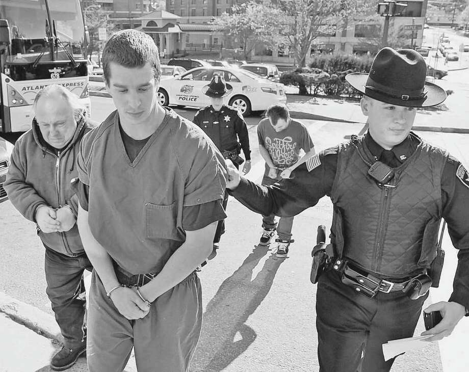 Jeffrey Hampshire is led to Saratoga City Court by a Saratoga County Sheriff's deputy at City Hall in Saratoga Springs, New York April 15, 2010.          (Skip Dickstein/Times Union) Photo: Skip Dickstein / 2008