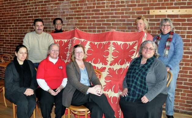 Norwalk Quilt Trail committee members are, clockwise, from far left, Anna Veccia (seated), Peter Bondi, Diane Jellerette, Wendell Livingston, Dana Laird, Lesley Korzennik, Laura Macaluso and Rita Phillips. The committee has put out a call for quilts made and collected in Norwalk, in advance of the start of the Norwalk Quilt Trail, a six-month collaborative exhibit. Photo: Contributed Photo / Stamford Advocate Contributed