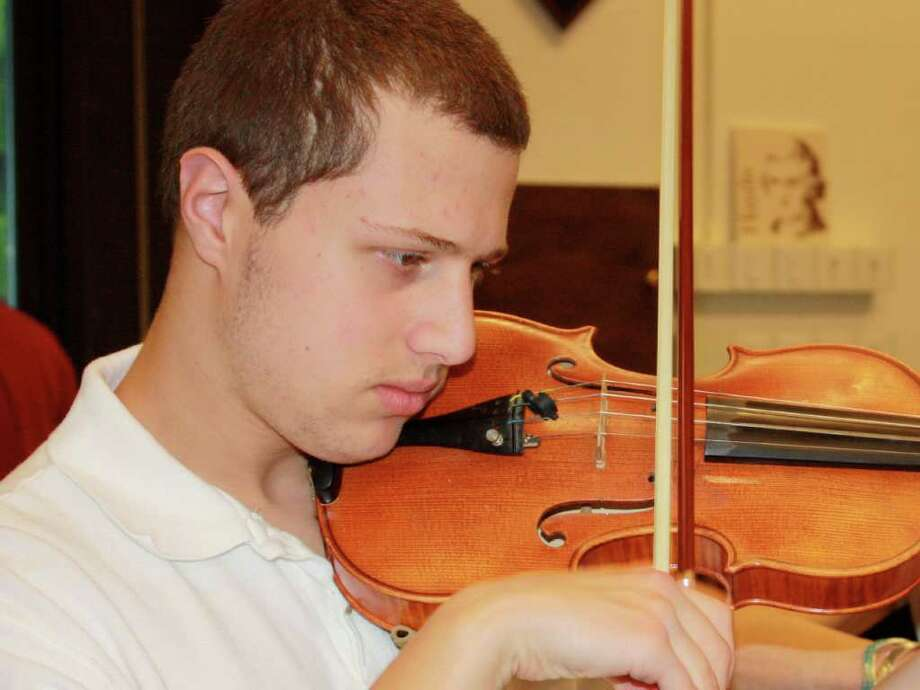 Isaac Ohring, a 16-year-old violinist from New Fairfield, will perform at Purchase College's 'The Autistic Mind, Music and the Brain' symposium March 22. Isaac is first violinist with the Danbury Community Orchestra and a violinist with the Not Ready for Prime Time Klemzer band of Danbury. Photo: Contributed Photo / Stamford Advocate Contributed