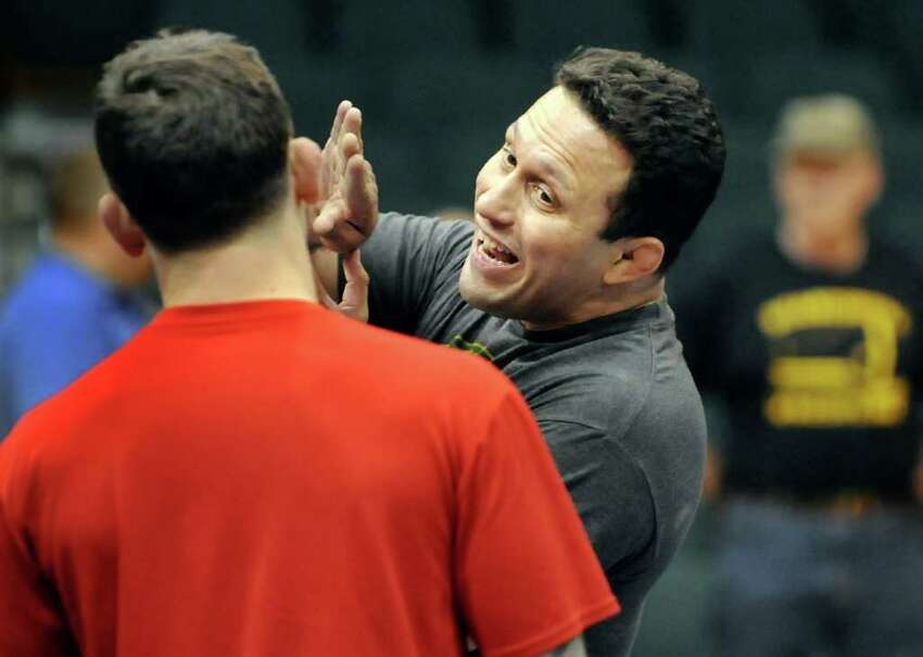 Brazilian jujitsu master Renzo Gracie, right, talks about the craft with former wrestler Frankie Edgar as the Ultimate Fighting Championship holds a demonstration on Tuesday, March 15, 2011, at the Washington Avenue Armory in Albany, N.Y. (Cindy Schultz / Times Union)