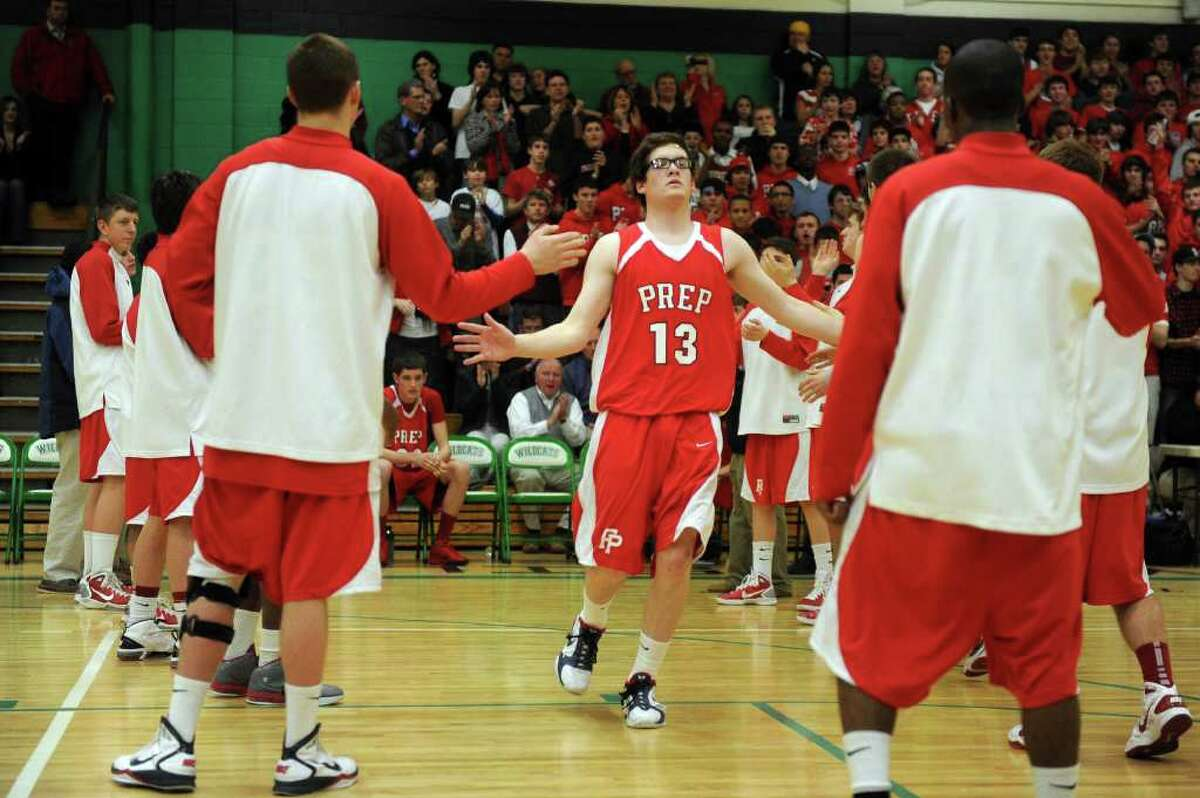Fairfield Prep's Kevin Potter is welcomed to the court during Tuesday's class LL semifinal game at Wilby High School in Waterbury on March 15, 2011.