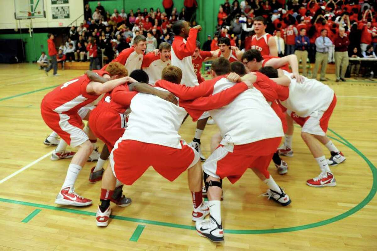 Fairfield Prep gets excited before Tuesday's class LL semifinal game at Wilby High School in Waterbury on March 15, 2011.
