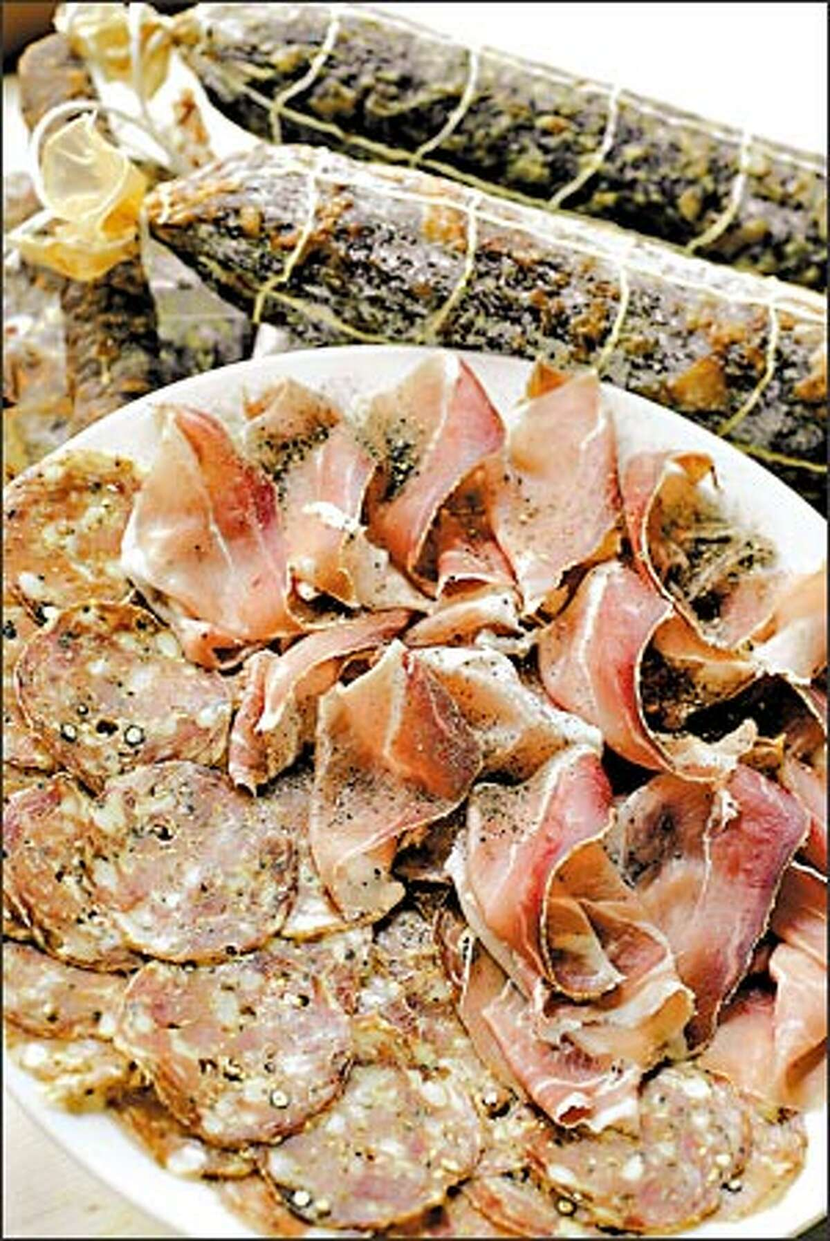 Finnocchiona and culatello are two of the 15 artisan meats available at Salumi. The meat and sandwich shop serves dinner one night a week, and is already booked through the end of the year.