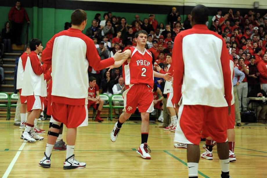 Fairfield Prep's Robbie Bier is welcomed to the court during Tuesday's class LL semifinal game at Wilby High School in Waterbury on March 15, 2011. Photo: Lindsay Niegelberg / Connecticut Post
