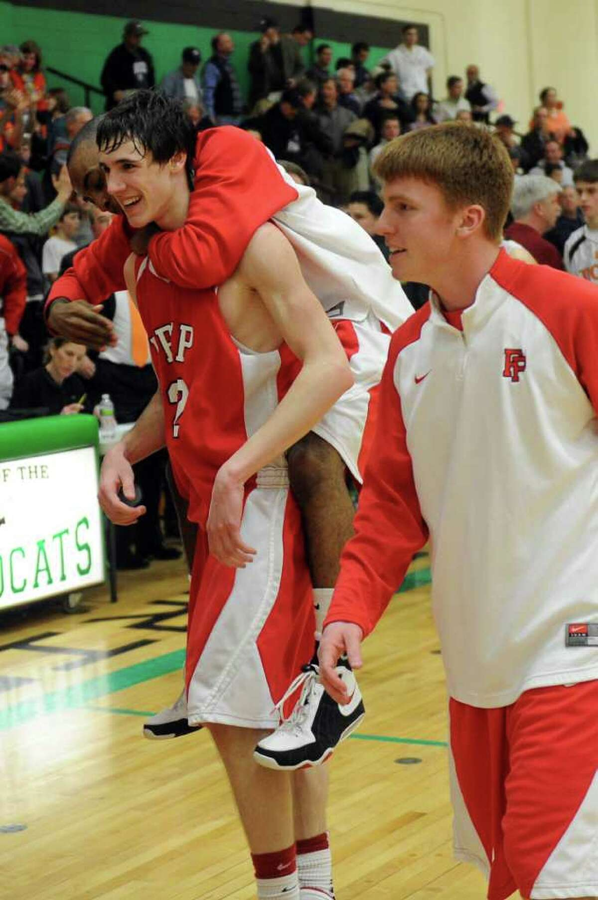 Fairfield Prep players react to winning Tuesday's class LL semifinal game at Wilby High School in Waterbury on March 15, 2011.