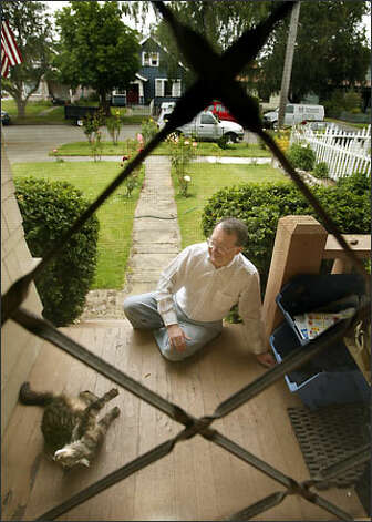 "James Gaylord and his cat Katya on the porch of his North End Tacoma home. Gaylord was fired from his teaching job in 1972 when an assistant principal came to his house and asked Gaylord if he was gay. Gaylord said ""yes."" Photo: Scott Eklund/Seattle Post-Intelligencer"