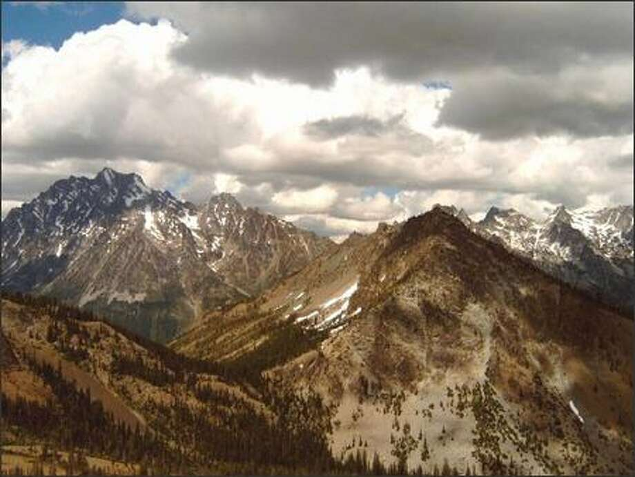 The summit ridge of Iron Peak offers an outstanding view of 9,415-foot Mount Stuart, at left. Photo: KAREN SYKES