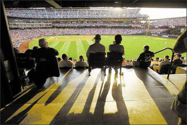 Baseball fans enjoy a game at Safeco Field earlier this year between the M's and th