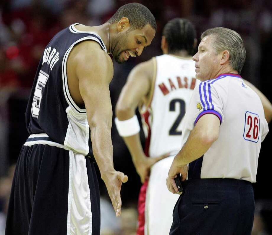 Spurs' forward Robert Horry talks with official Bob Delaney during Game 3 of the NBA Finals against the Cleveland Cavaliers in 2007. Photo: BAHRAM MARK SOBHANI, Express-News File Photo / SAN ANTONIO EXPRESS-NEWS