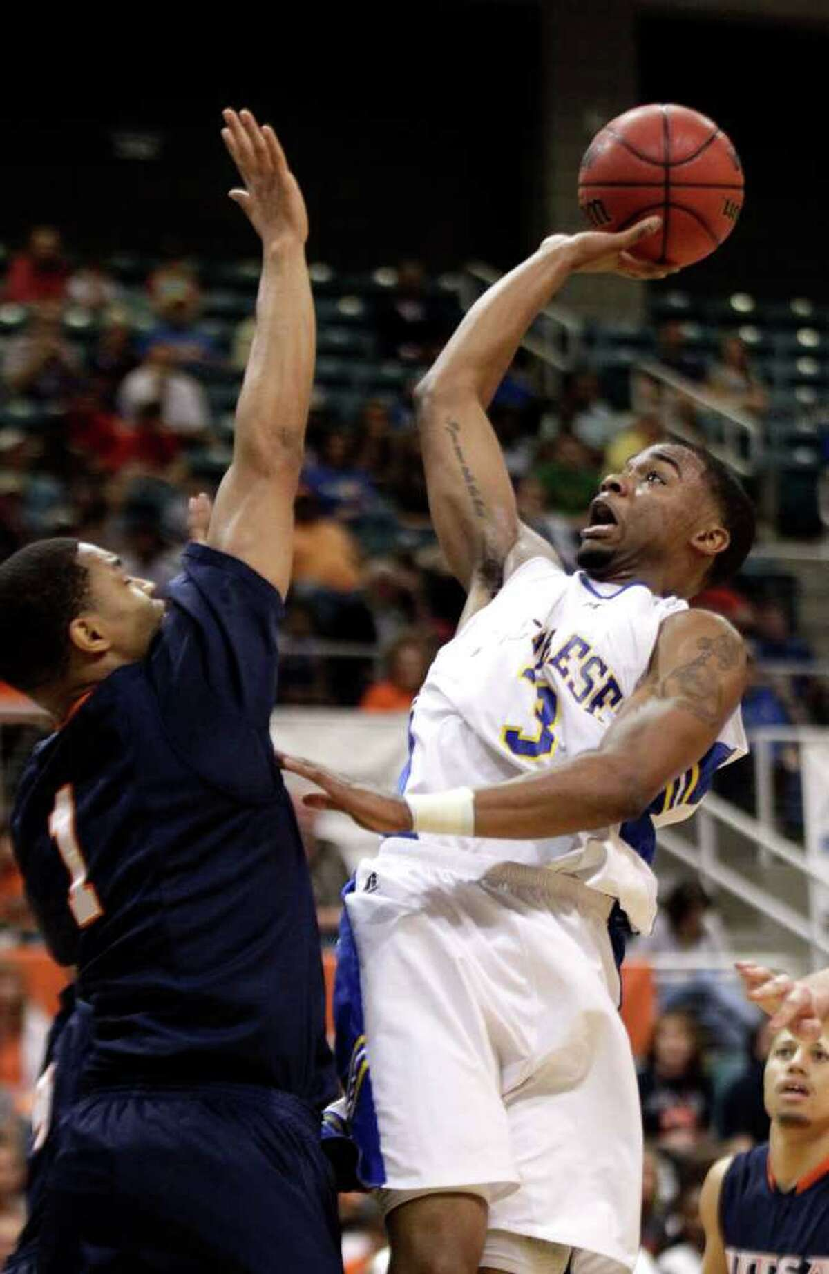 McNeese State's Patrick Richard shoots as UTSA's Stephen Franklin defends during the first half of the Southland Conference tournament championship on Saturday, March 12, 2011, in Katy. UTSA won 75-72.