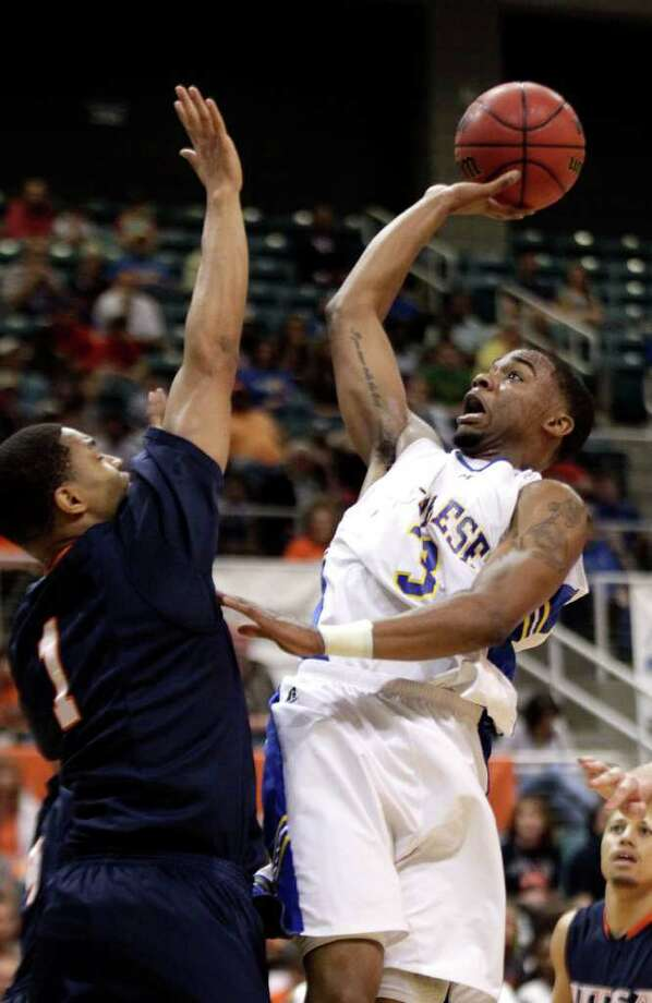 McNeese State's Patrick Richard shoots as UTSA's Stephen Franklin defends during the first half of the Southland Conference tournament championship on Saturday, March 12, 2011, in Katy. UTSA won 75-72. Photo: David J. Phillip/Associated Press