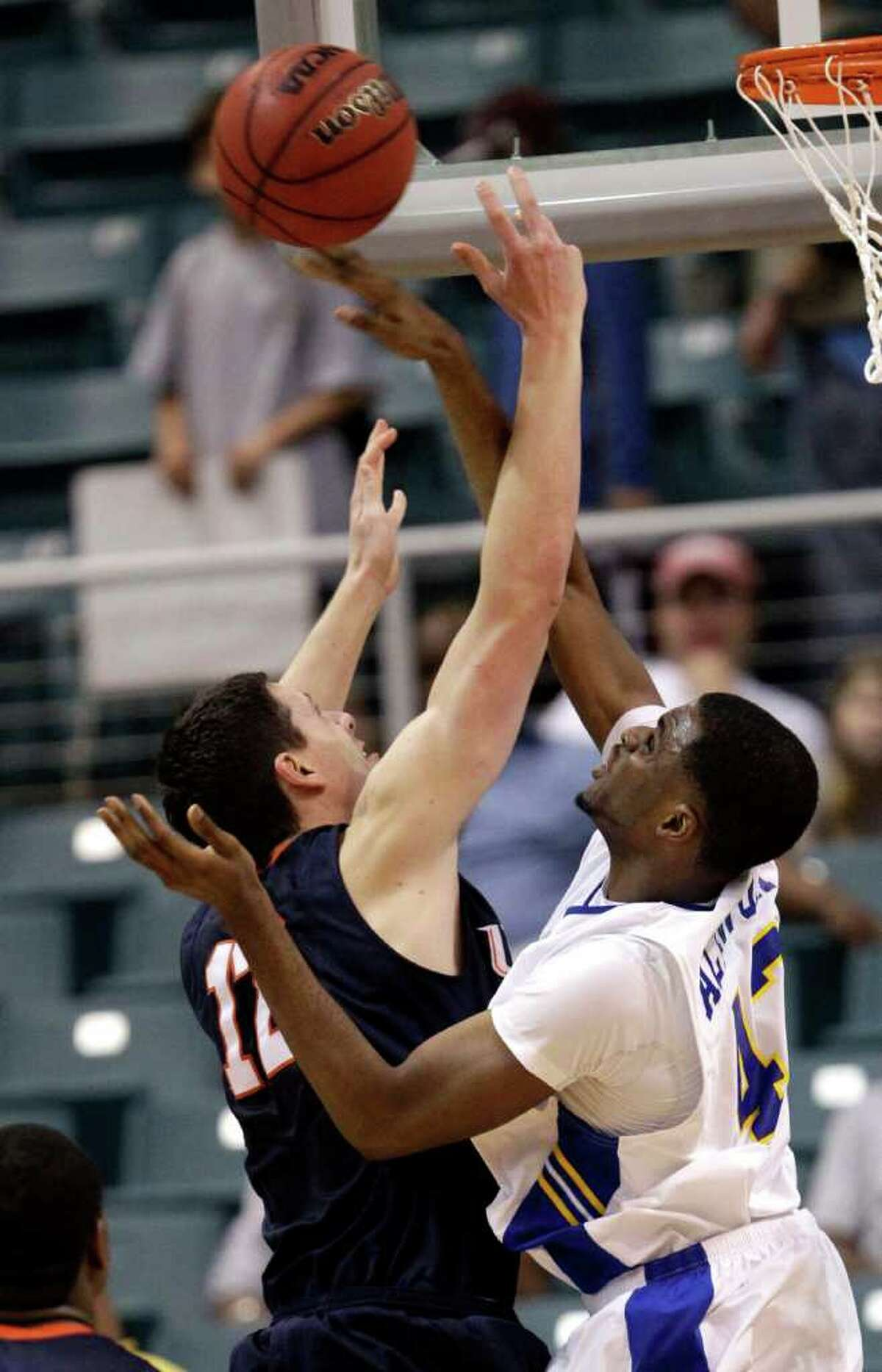 UTSA's Jeromie Hill has his shot blocked by McNeese State's P.J. Alawoya during the first half of the Southland Conference tournament championship on Saturday, March 12, 2011, in Katy. UTSA won 75-72.