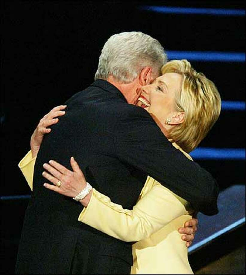 Former President Bill Clinton hugs his wife, Sen. Hillary Rodham Clinton, D-N.Y., after she introduced him at the Democratic National Convention. Photo: Karen Ducey/Seattle Post-Intelligencer