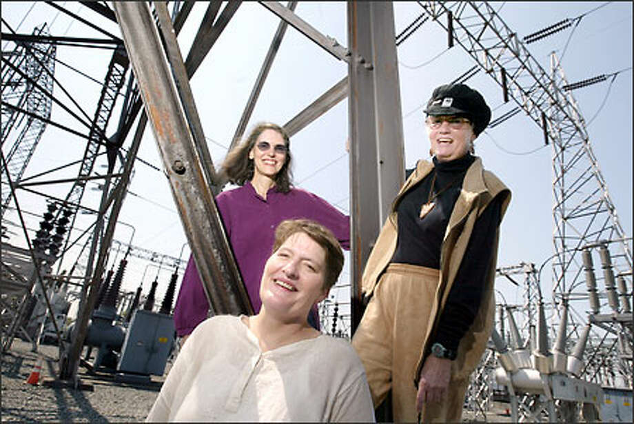 Megan Cornish, left, Heidi Durham, center, and Teri Bach jumped at the chance to train in Seattle City Light's Electrical Trades Program when it was opened to women in 1973. Their efforts over the past 30 years brought changes to the pretraining and apprenticeship programs, city officials say. Photo: Scott Eklund/Seattle Post-Intelligencer